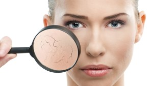 Beautiful woman, skin close up with a magnifying glass